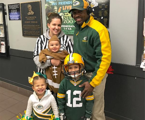 family-with-packers-coach